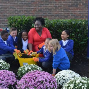 Pupils and staff from Foxfield Primary School planting flower beds