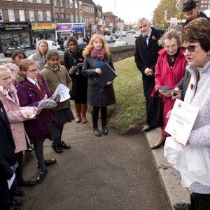 Cllr Denise Hyland talking to children from Eltham CoE Primary at Eltham War Memorial