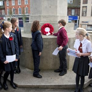 Eltham CoE Primary children laying wreath at Eltham War Memorial