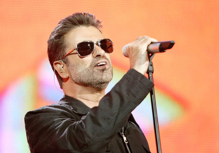 "Singer George Michael performs on stage at ""Live 8 London"" in Hyde Park on July 2, 2005. (Photo by MJ Kim/Getty Images)"