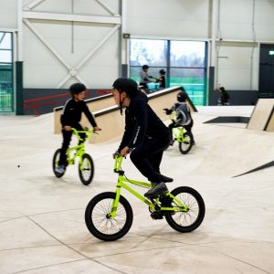 Young residents using the indoor BMX/Skatepark