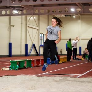 Alisa tries out the long jump at Sutcliffe Park Sports Centre